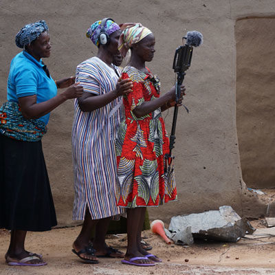A group of widows support each other to make a video in northern Ghana