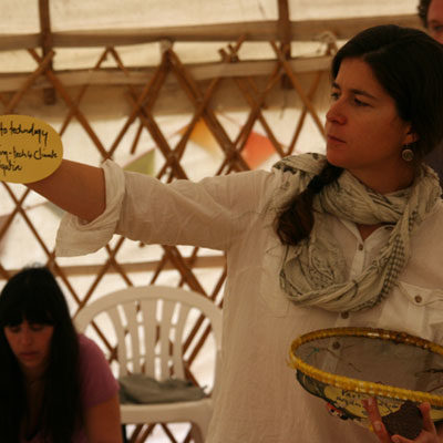 A Participatory Video facilitator holds a card during a workshop