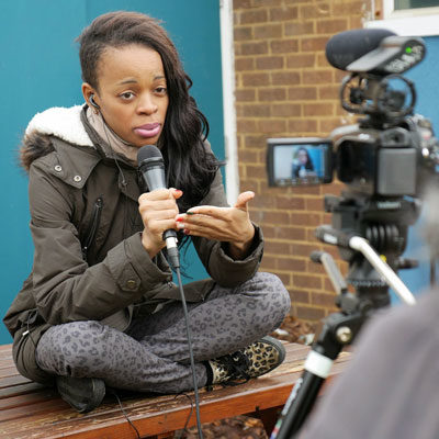 A young woman tells her story to camera during a PV MSC process