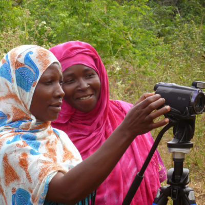 Women using camera during Participatory Video project in Tanzania