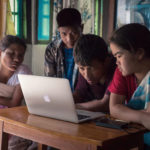 Indigenous Khasi youth edit their Participatory Videos on a laptop