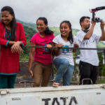 Indigenous Naga youth stand on back of a truck to record their Participatory Video