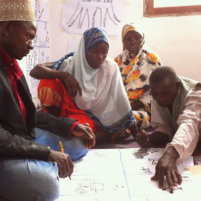 A group make a storyboard for their Participatory Video in Tanzania