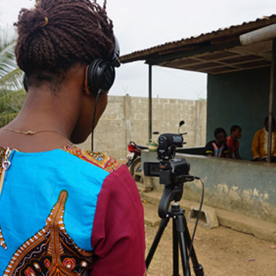 A woman using the camera during a Participatory Video project in Sierra Leone