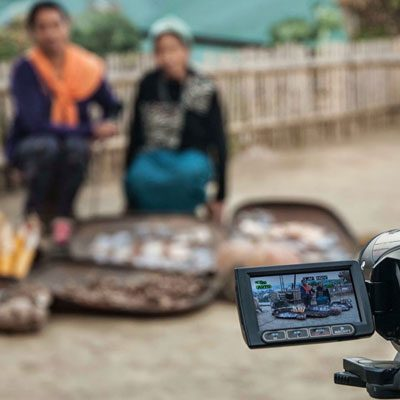 Two women showing their traditional seeds during a Participatory Video process in Nagaland