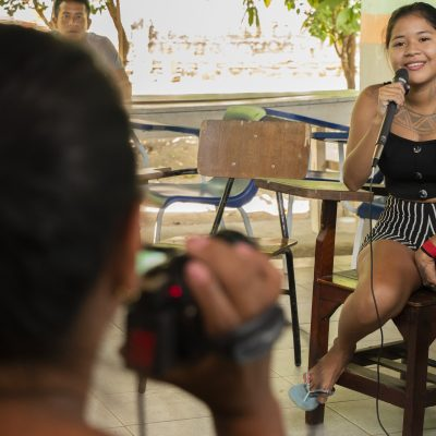 Photo of participatory video training with participant being interviewed during training. Training facilitated by La Marabunta Filmadora in Brazil with Guajajara indigenous people