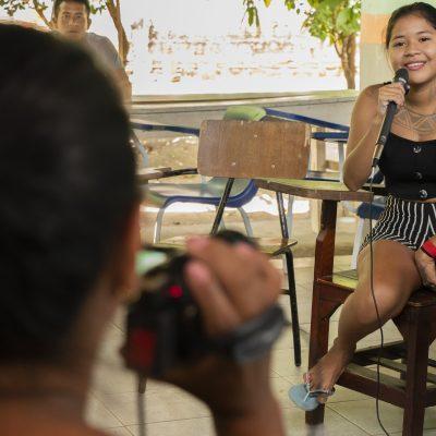 Photo of participatory video training with participant being interviewed during training. Training facilitated by La Marabunta Filmadora in Brazil with Guajajara indigenous people