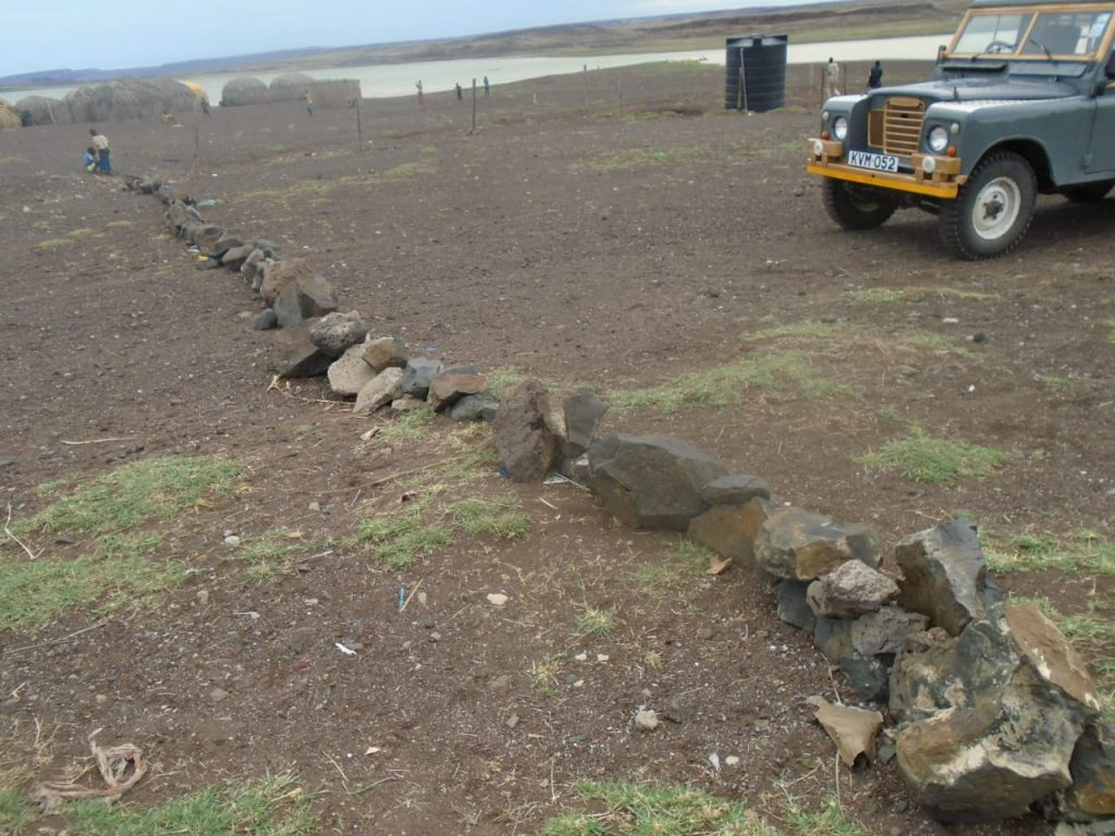stones block the way into the village of El Molo Kenya to contain Padndemic