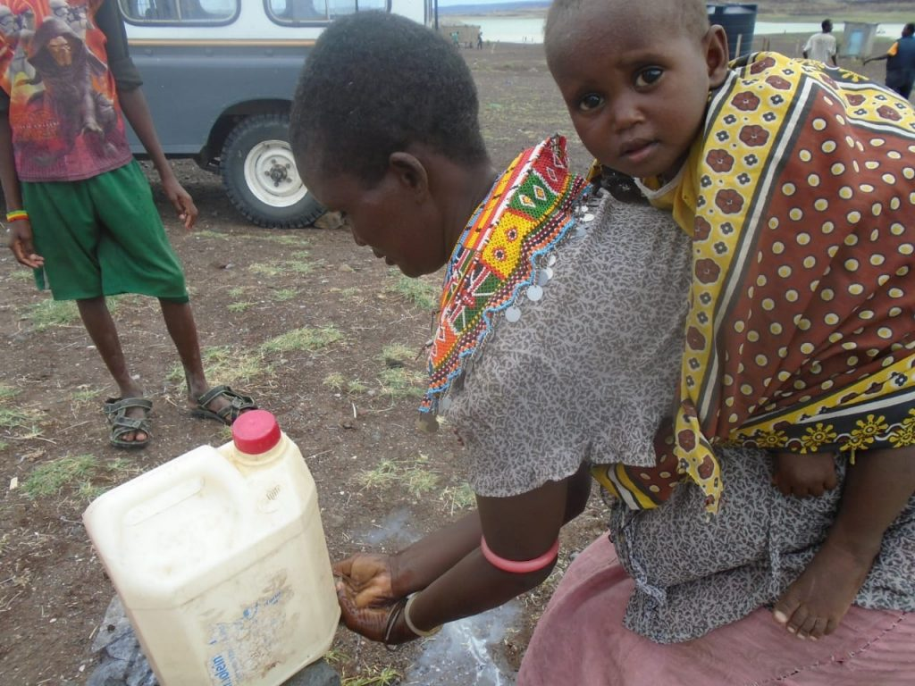 in El Molo Kenya A woman washes her hands after visiting town to protect herself against COVID-19
