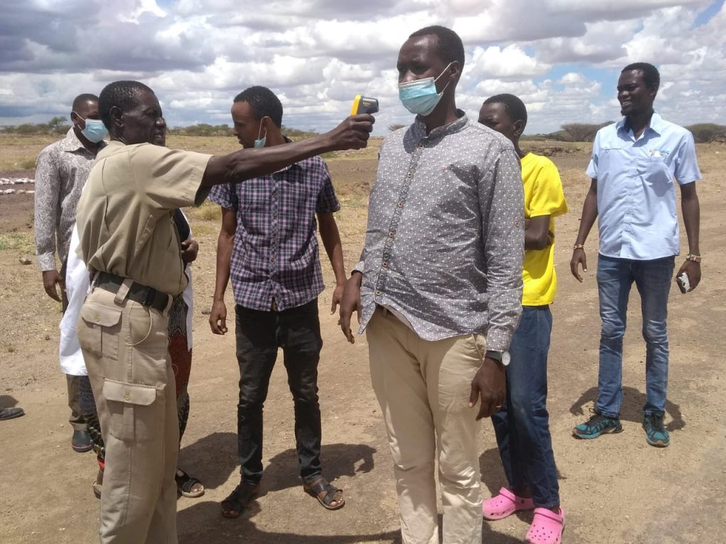 on the El-Molo border community organises screening to monitor fever and illness of those who enter village