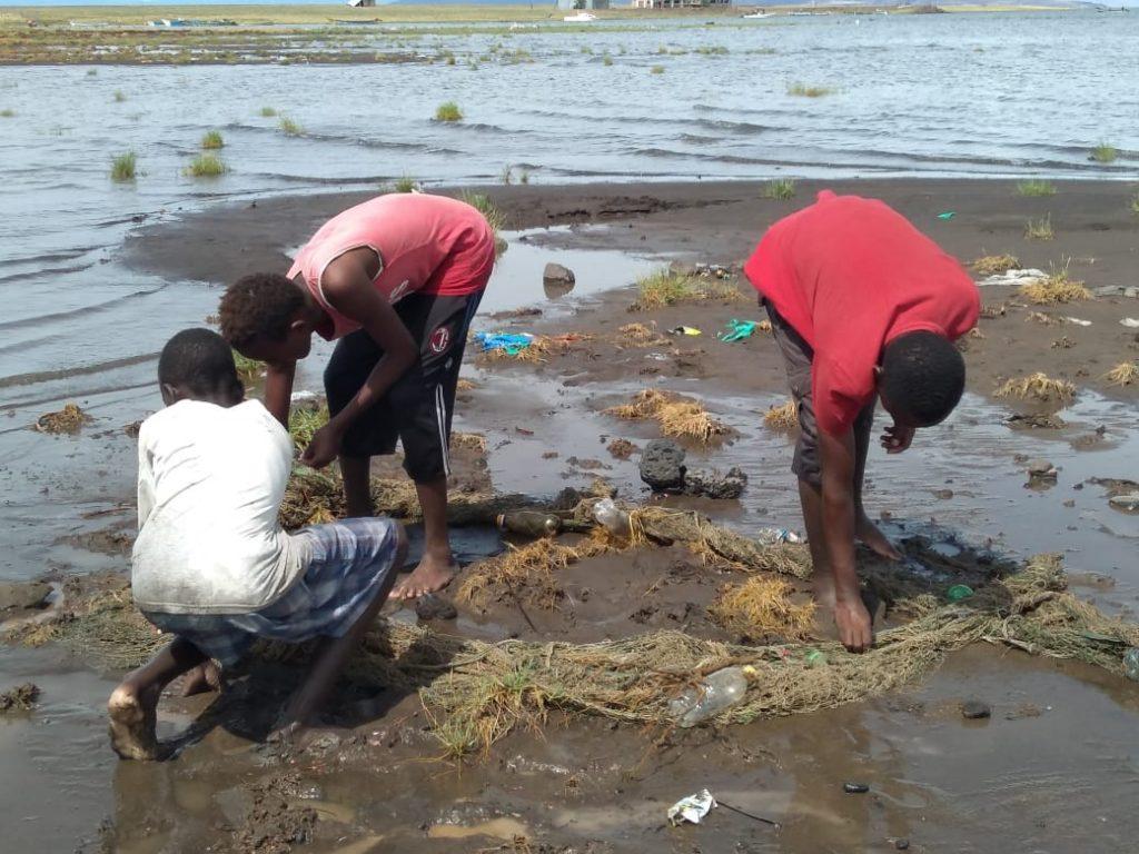 El Molo, Kenya young boys fishing for fingerlings to use as bait in Lake Turkana