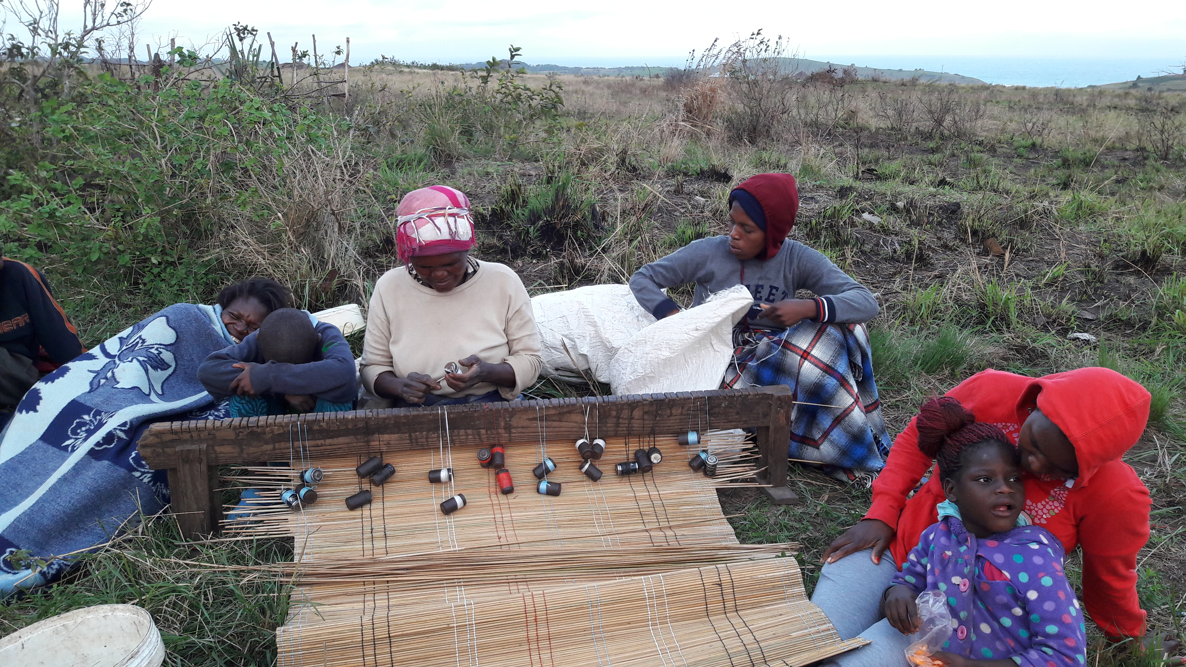 Community making mats in Amadiba during cover-19