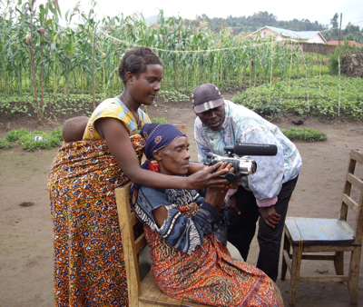 Batwa people learn how to use and handle digital equipment during the training.